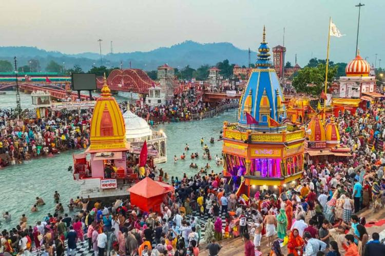 Devotees gather to offer prayers during the third Shahi Snan of the Kumbh Mela 2021 at Har ki Pauri Ghat in Haridwar on April 14 2021