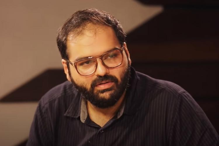 Comedian Kunal Kamra wearing a black t-shirt and spectacles
