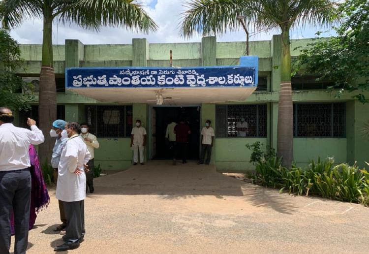 Healthcare workers standing outside Kurnool Government Hospital