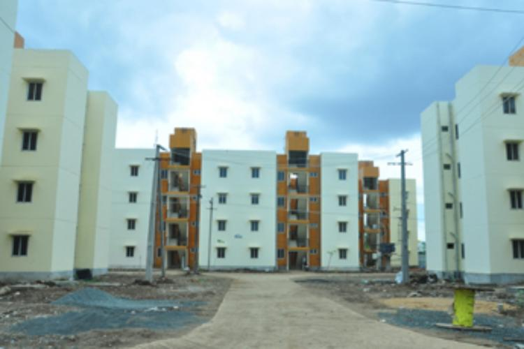 Andhra Affordable Housing Project in Kurnool white and brown buildings with 4 storeys