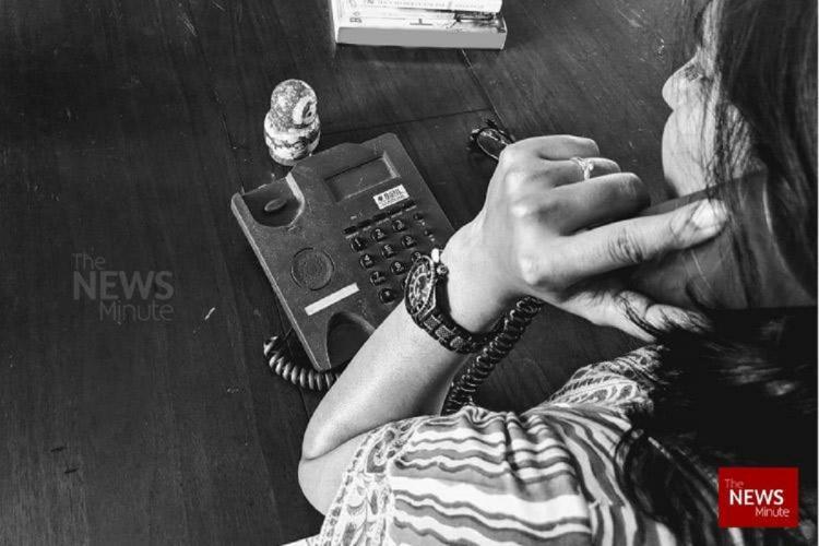 Woman talking on a landline phone