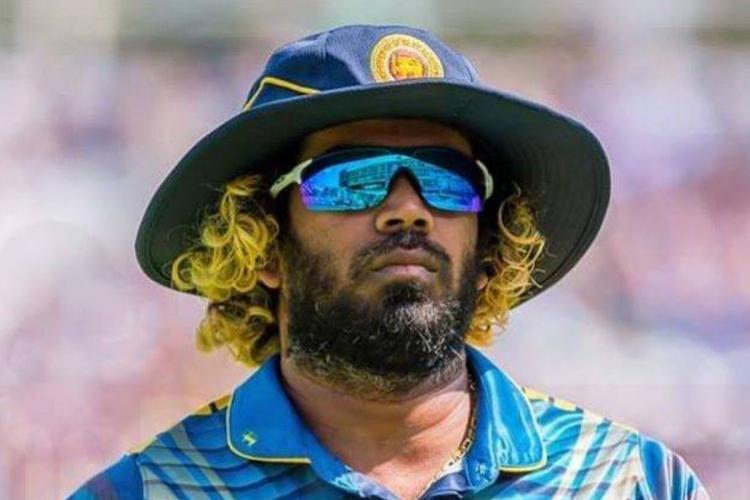 Lasith Malinga in a blue jersey wearing reflective sunglasses