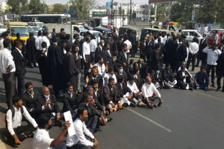 Lawyers blocking a road in Hyderabad in protest against the murder of Telangana lawyer couple