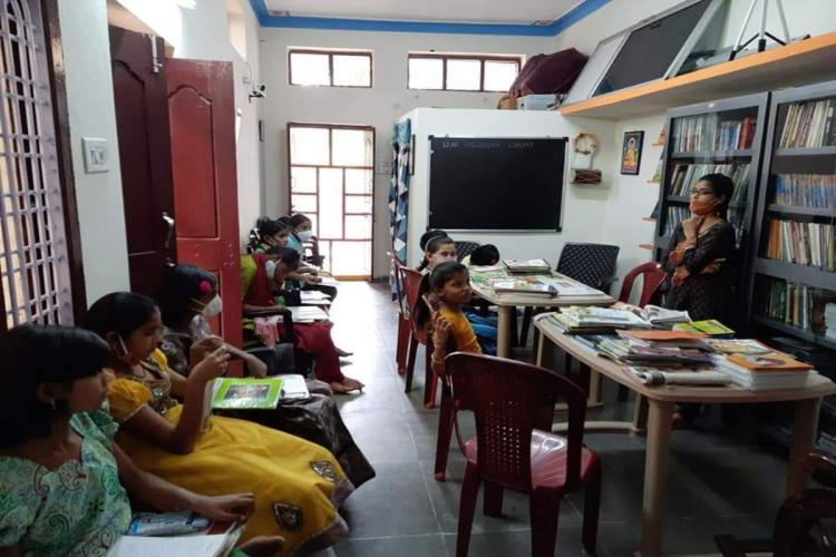 Children from the locality engaging in reading at Lead Children Library at Narsampet of Warangal rural district in Telangana