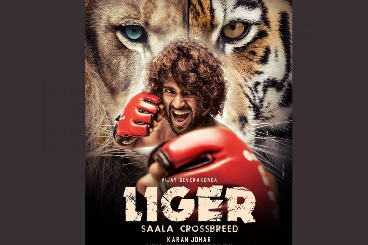 Vijay Deverakonda on the post of Liger wearing boxing gloves and standing in stance of a boxer with a lion and tiger in the backdrop