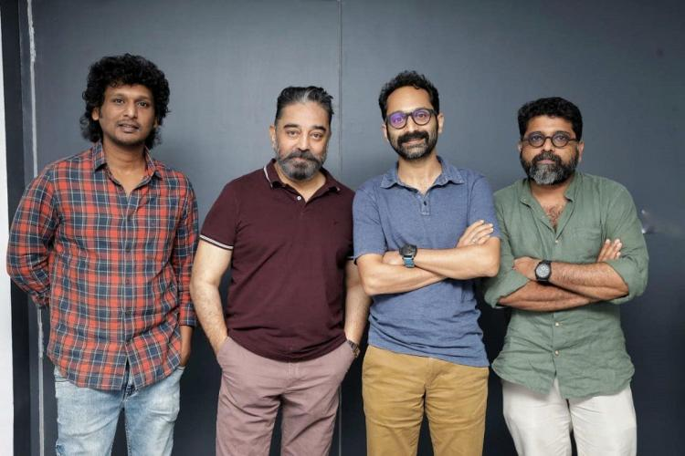 Logesh, Kamal Haasan, Fahadh and Mahesh stand next to each other posing for the camera against a grey background