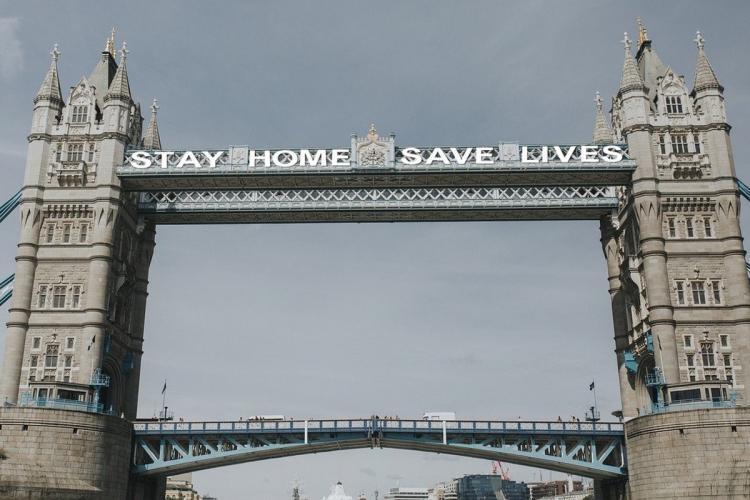 A scene from London Bridge Stay Homes Save Lives written across the bridge