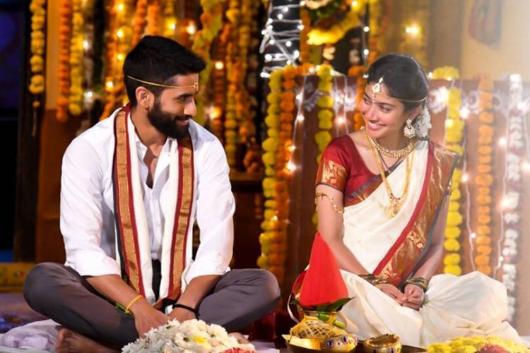 Naga Chaitanya and Sai Pallavi in Love Story poster dressed as bride and groom for a Telugu Hindu wedding ceremony