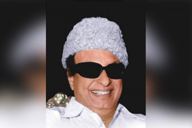 MG Ramachandran wears sunglasses his fur cap and smiles for the camera
