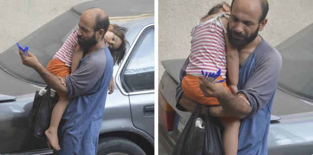 Photos of refugee selling pens while carrying his sleeping daughter sparks online fundraising campaign