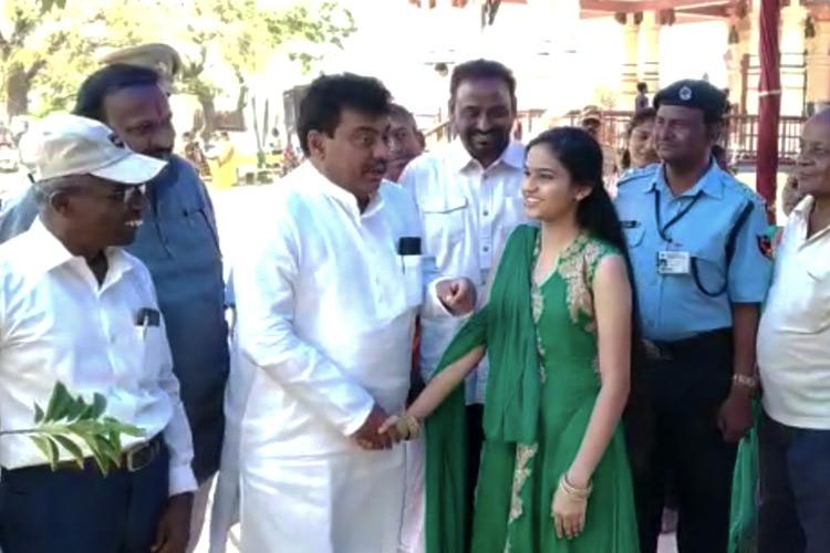 Stand in queue Girl tells Ktaka Minister MB Patil who jumped line at temple