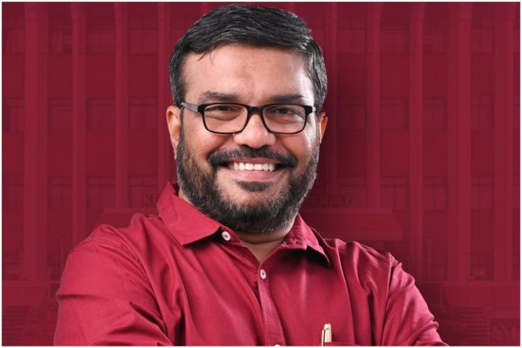 Kerala Assembly Speaker MB Rajesh in a maroon shirt smiling and posing for a picture