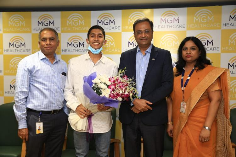 The 26-year-old patient posing with doctors of MGM Healthcare after his successful surgery