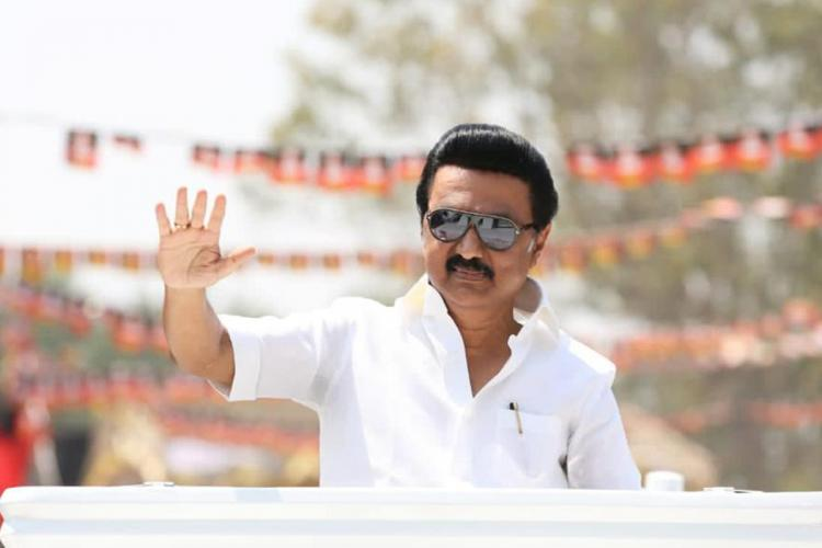 MK Stalin waves to the crowd at an election rally in Tamil Nadu
