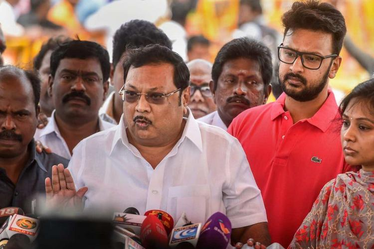 Former union minister MK Alagiri with his family members addresses the media after paying homage to his late father and DMK patriarch M Karunanidhi at his memorial on Marina Beach in Chennai on Monday Aug 13 2018
