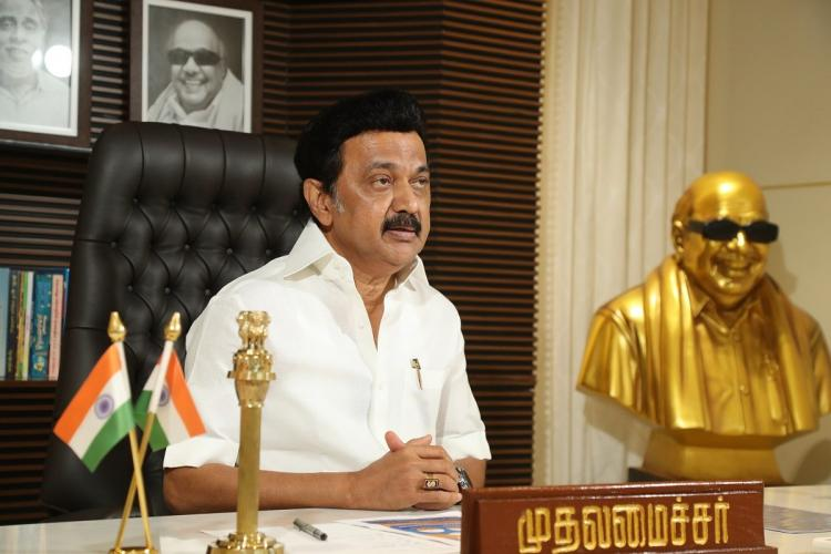 MK Stalin in his office with a golden bust of Karunanidhi on the side