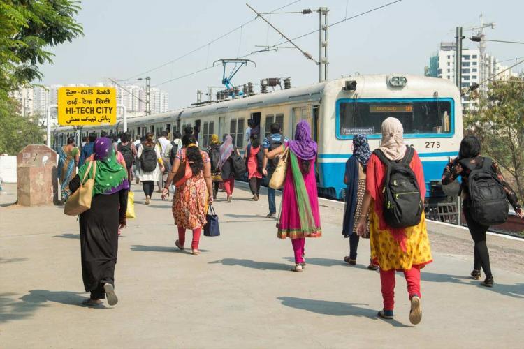 A group of women walking towards an MMTS train in Hyderabad