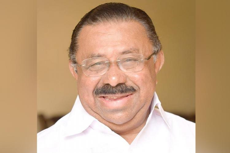 Congress leader in Kerala MM Hassan smiling.