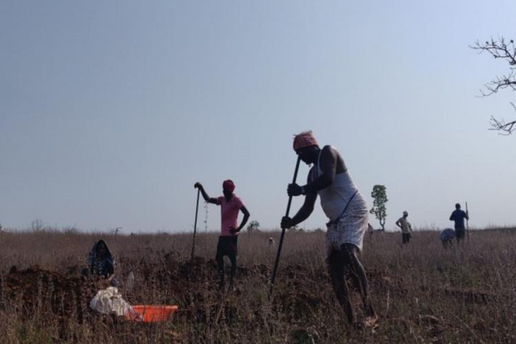 NREGA workers in Telangana engaged in work near a village