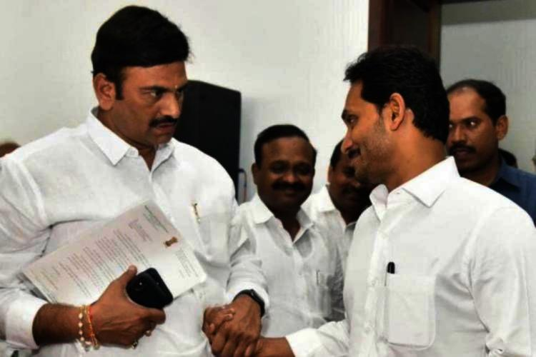 YSRCP MP Raghu Rama Krishnam Raju interacting with CM YS Jagan Mohan Reddy