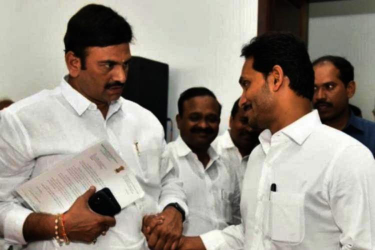 YSRCP MP Raghurama Krishnam Raju and Andhra Chief Minister Jagan Mohan Reddy looking at each other, wearing white clothes