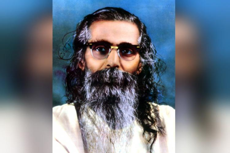 Golwalker with his long black and grey hair and beard and specs