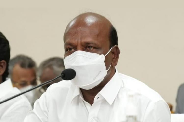 Tamil Nadu Health Minister Ma Subramanian wearing a white mask and speaking into a mic