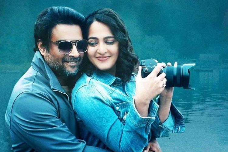 Madhavan and Anushka in matching blue holding camera