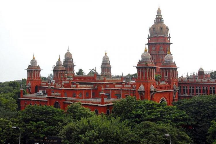 Red building Madras High Court in the middle of greenery