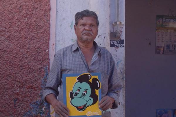 Madurais Mickey Man The artist who paints cartoons all over the citys auto-rickshaws