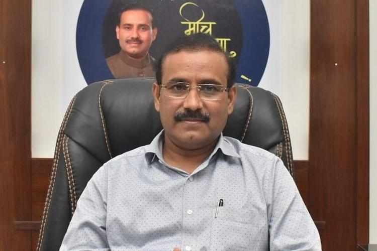 A file image of Maharashtra Health Minister Rajesh Tope sitting on a leather chair wearing a grey shirt and looking into camera