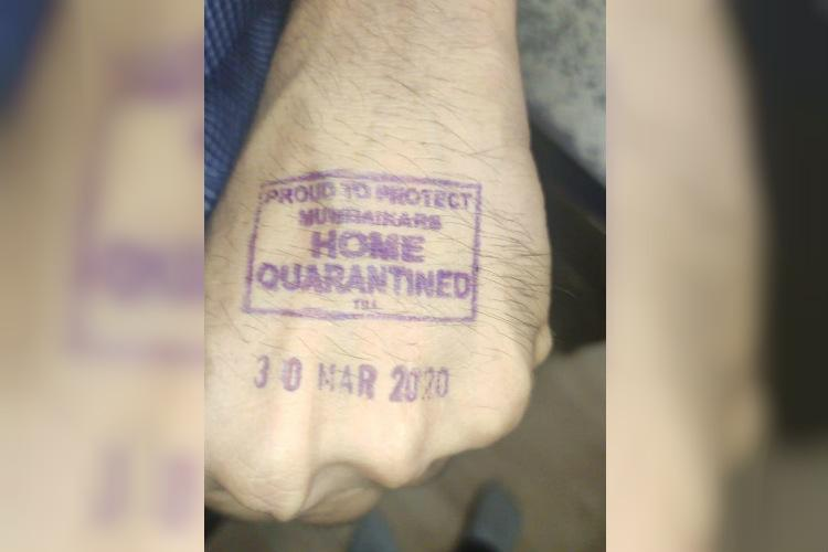 Indian state uses hand-stamps to identify quarantined persons