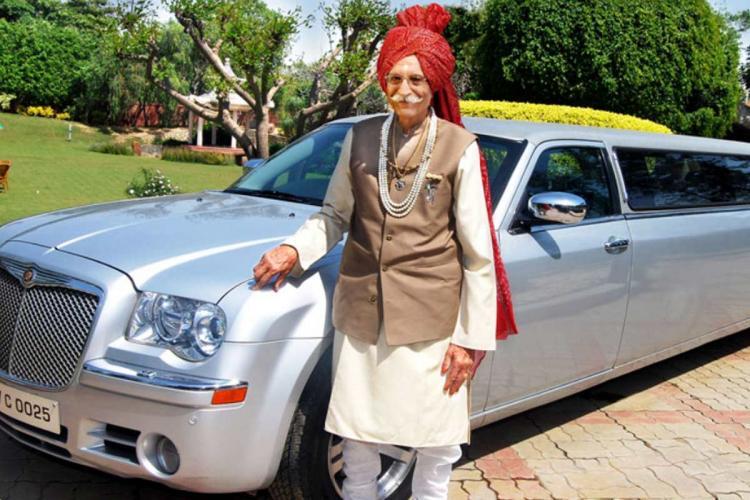 File photo of Mahashay Dharampal Gulati standing next to a Rolls Royce car