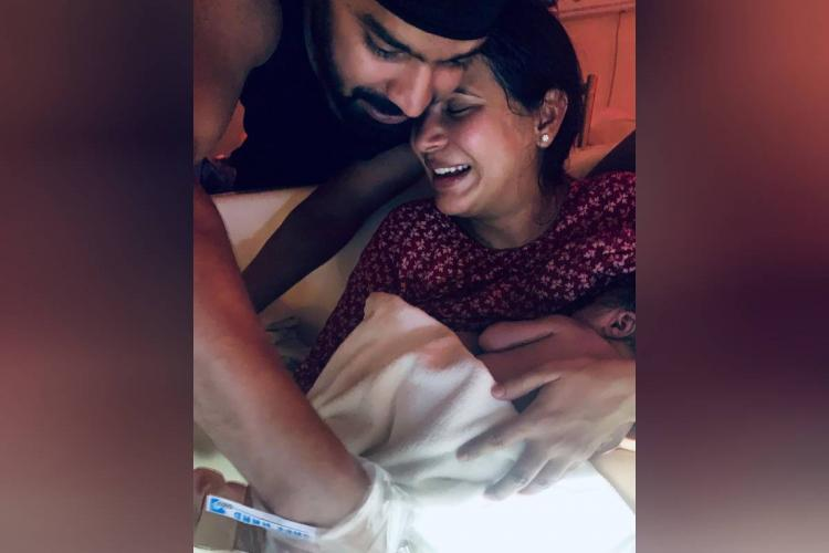 Mahat and Prachi are seen holding their newborn baby