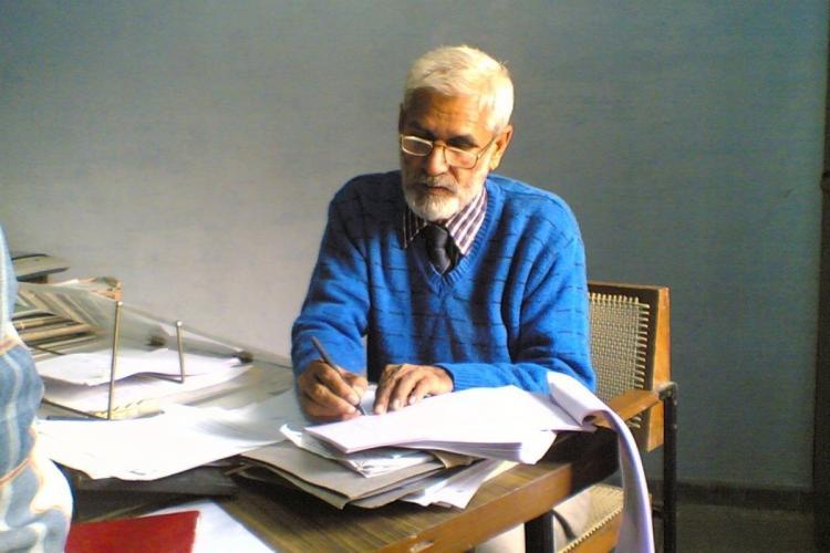 Mahavir Narwal seated and working