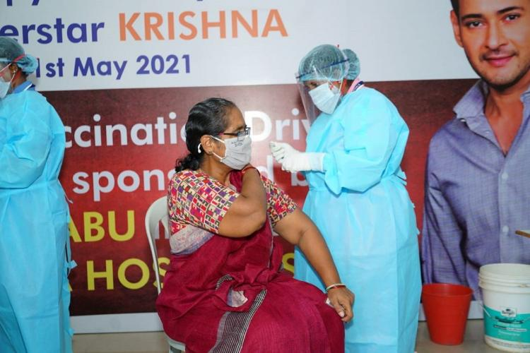 Mahesh Babus vaccination drive in which a senior citizen is getting vaccinated from a health care worker