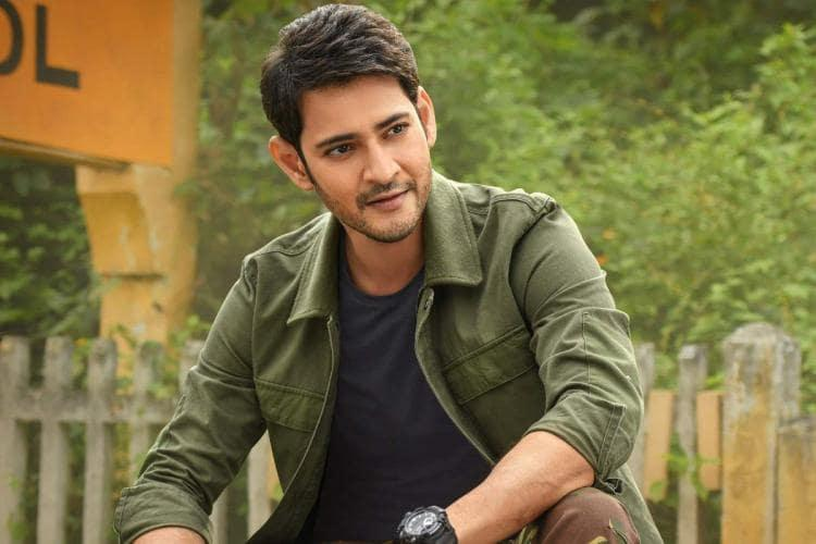 Mahesh Babu is seen wearing a blue tee and olive green jacket in the image