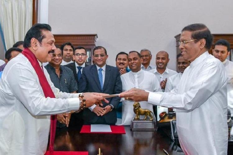 Amid high drama former Sri Lankan President Mahinda Rajapaksa sworn in as new PM