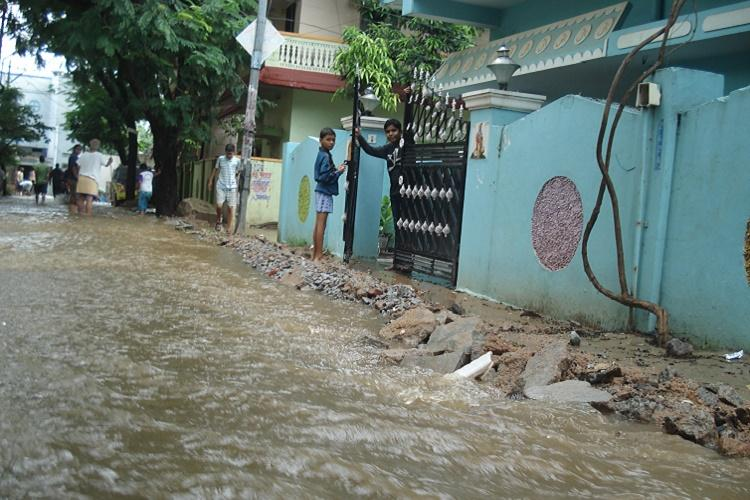 In rain hit Hyderabad a lake spews sewage onto the streets