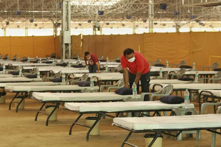 Workers give final touches to the makeshift 10000 bed COVID-19 facility being prepared at Radha Soami Satsang Beas grounds amid rising number of coronavirus cases in the national capital in New Delhi