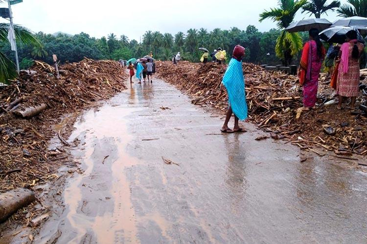 Kerala rains IMD issues red warning in three districts for Tuesday