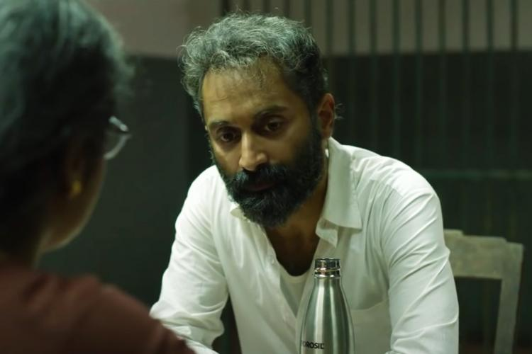Fahadh Faasil as Suleiman in Malik film wearing a white shirt and sporting grey hair