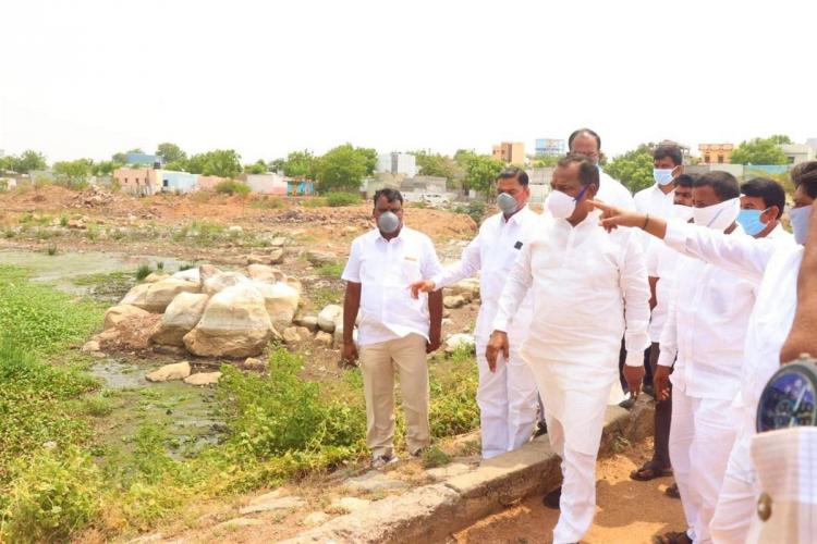 Telangana Minister Malla Reddy inspecting a lake in Hyderabad
