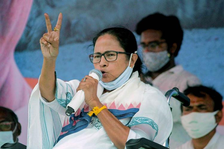 Mamata Banerjee flashes victory sign