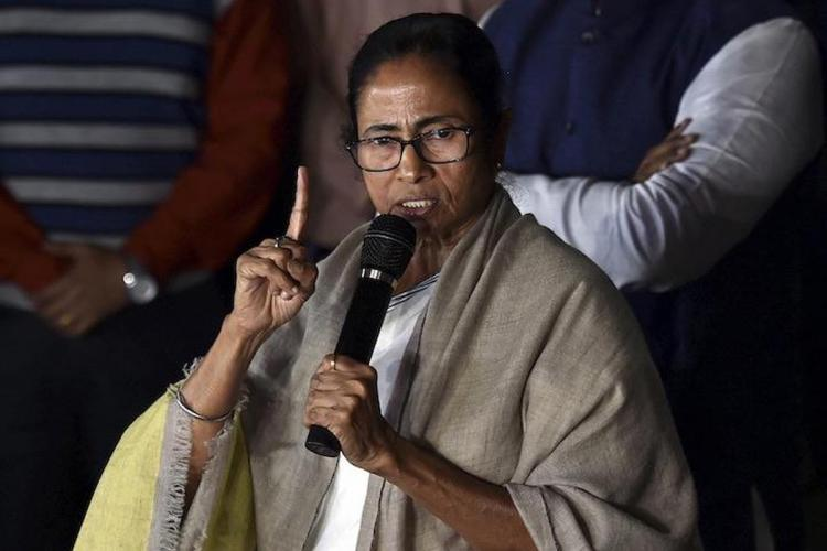 Mamata Banerjee talking with a mic in her hand