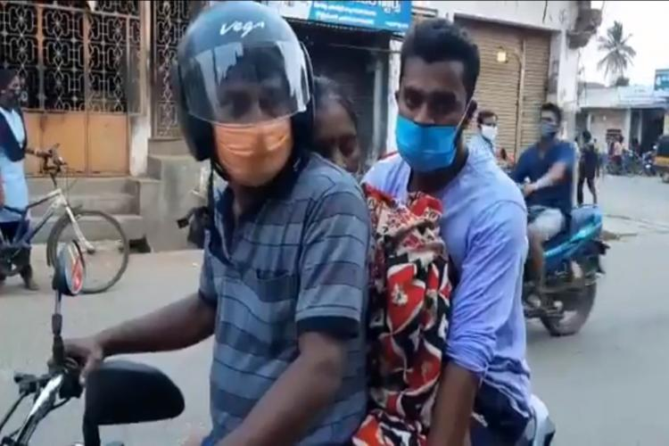 Man carries his mother on bike for cremation in Andhra Pradesh