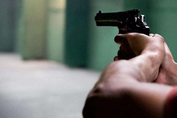 Representative image of a man firing a gun