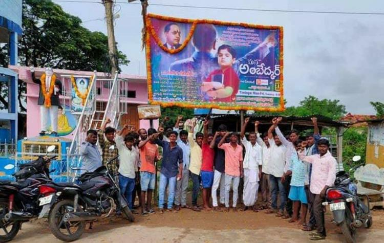 A group of villagers were seen standing at a junction in a village near Mana Ambedkar hoarding
