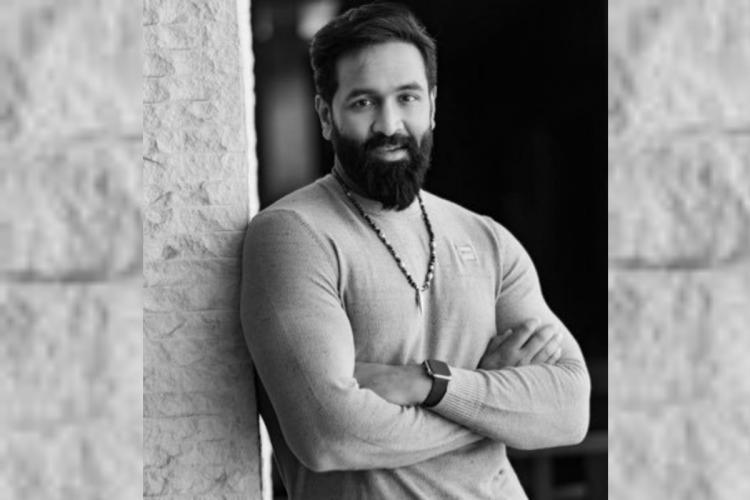Manchu Vishnu poses for a picture in a grey shirt