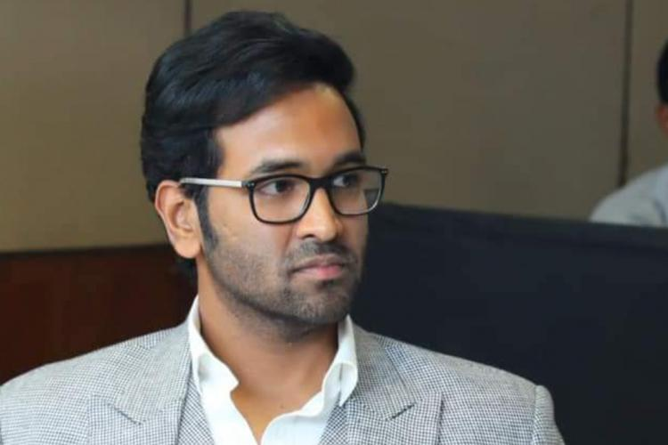 Manchu Vishnu, the new elected president of MAA wearing a suit with spectacles